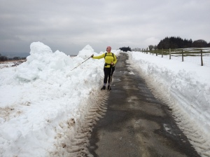 Snowplow-cleared lane 450m up on the hills